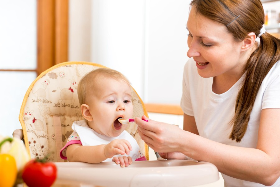 At five months babies will be able to take small amounts of pureed food from a spoon.